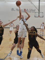 Marian High varsity player Megan Kraus elevates to get a shot off against Mercy.