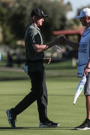 Adam Long fist bumps his caddy after he birdies 17 at La Quinta Country Club during the 3rd round of the Desert Classic on Saturday, January 19, 2019 in La Quinta. Long finished 3rd place for the day with 9 under and 19 under for the tournament.