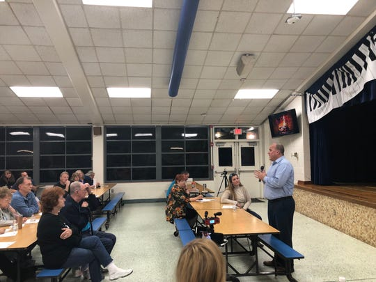 Brian Cooper, director of the city of Pensacola's Parks and Recreation department, speaks Thursday to Scenic Heights residents at a neighborhood meeting over the proposed soccer fields at Hitzman-Optimist Park.