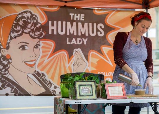Kristin Booker makes up some Hummus Saturday, January 19, 2019 at Palafox Market.