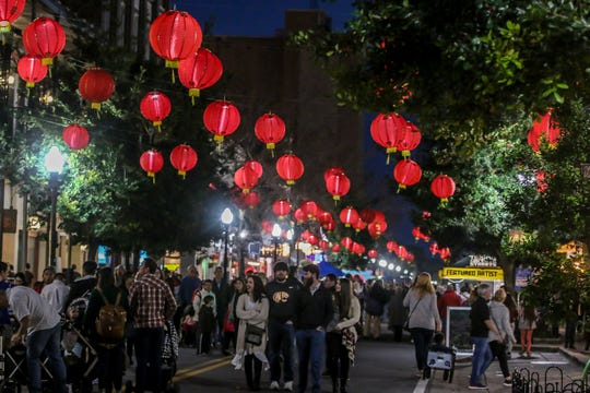 Chinese lanterns hang over Palafox Place in celebration of the Lunar New Year during Gallery Night on Friday, January 18, 2019.