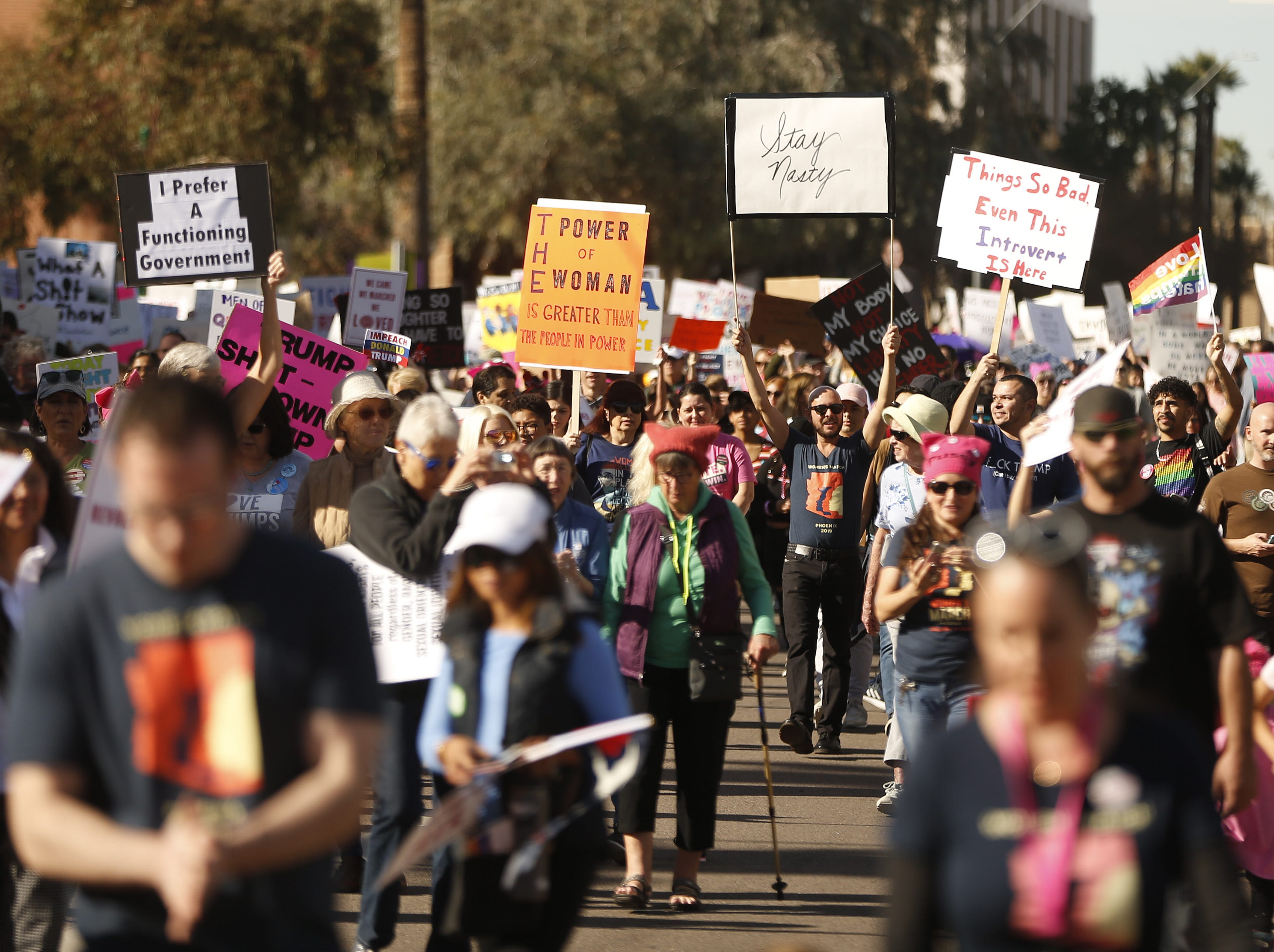 Women take to Jefferson street during the Women's March outside the state capital building in Phoenix,  Jan. 19, 2019.