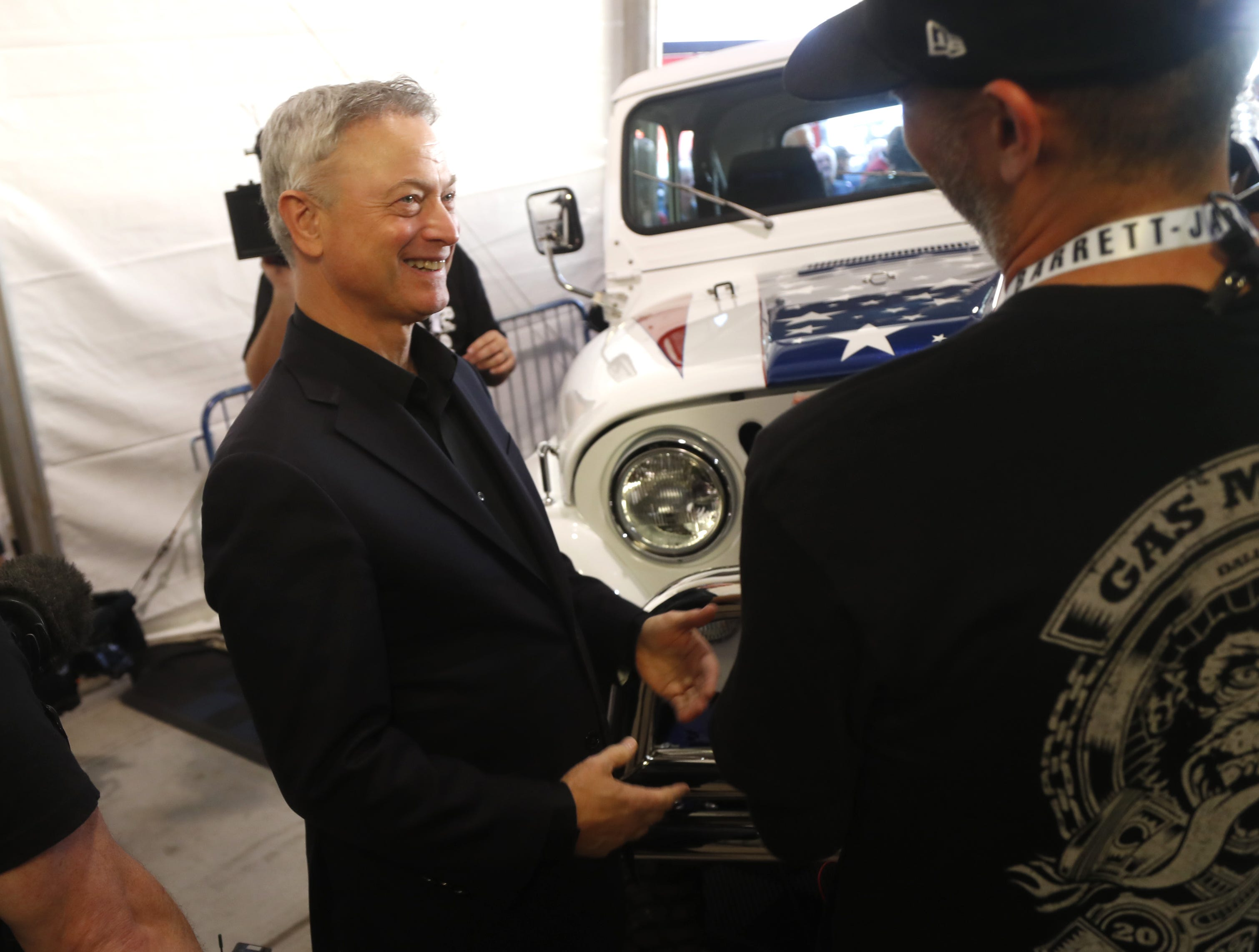Gary Sinise talks to people in front of a custom Jeep restored by Gas Monkey Garage in partnership with Sinise. The Jeep was auctioned off for the Gary Sinise Foundation at the Barrett-Jackson collector-car auction at WestWorld in Scottsdale on Jan. 18, 2019.