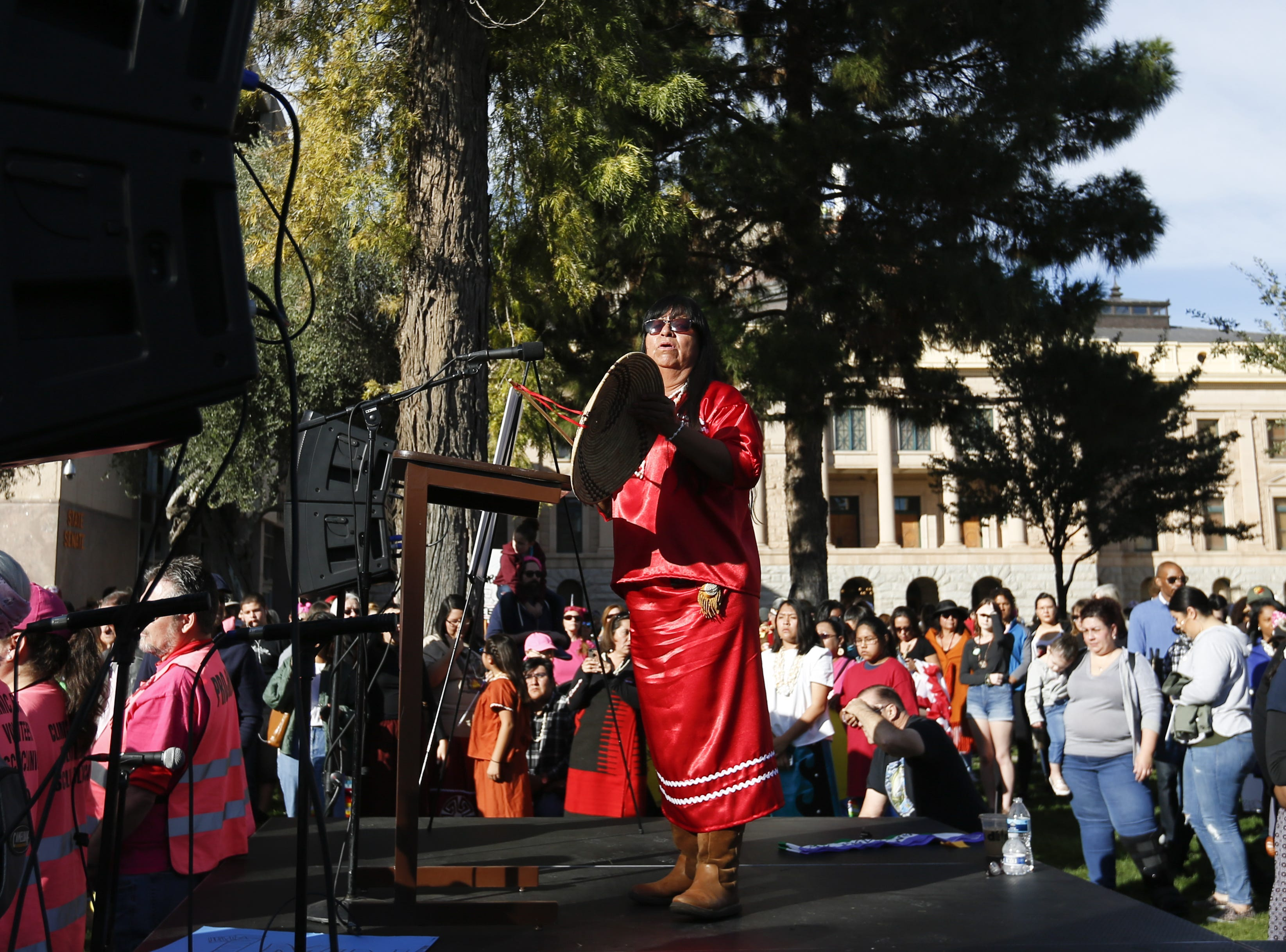 Pamela Thompson, a community manager within the Gila River Indian Community, sings a song at the Phoenix Women's March on Jan. 19, 2019, at the Arizona Capitol.