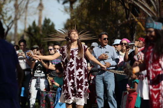 Gina Reyes performs a traditional dance with the Huehuecoyotl group at the Phoenix Women's March on Jan. 19, 2019, at the Arizona Capitol.