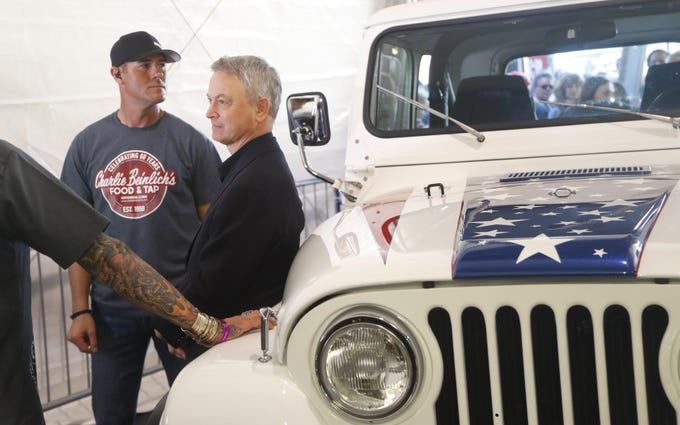 Gary Sinise leans back on a custom Jeep restored by Gas Monkey Garage in partnership with Sinise. It was auctioned off for the Gary Sinise Foundation at the Barrett-Jackson collector-car auction at WestWorld in Scottsdale on Jan. 18, 2019.