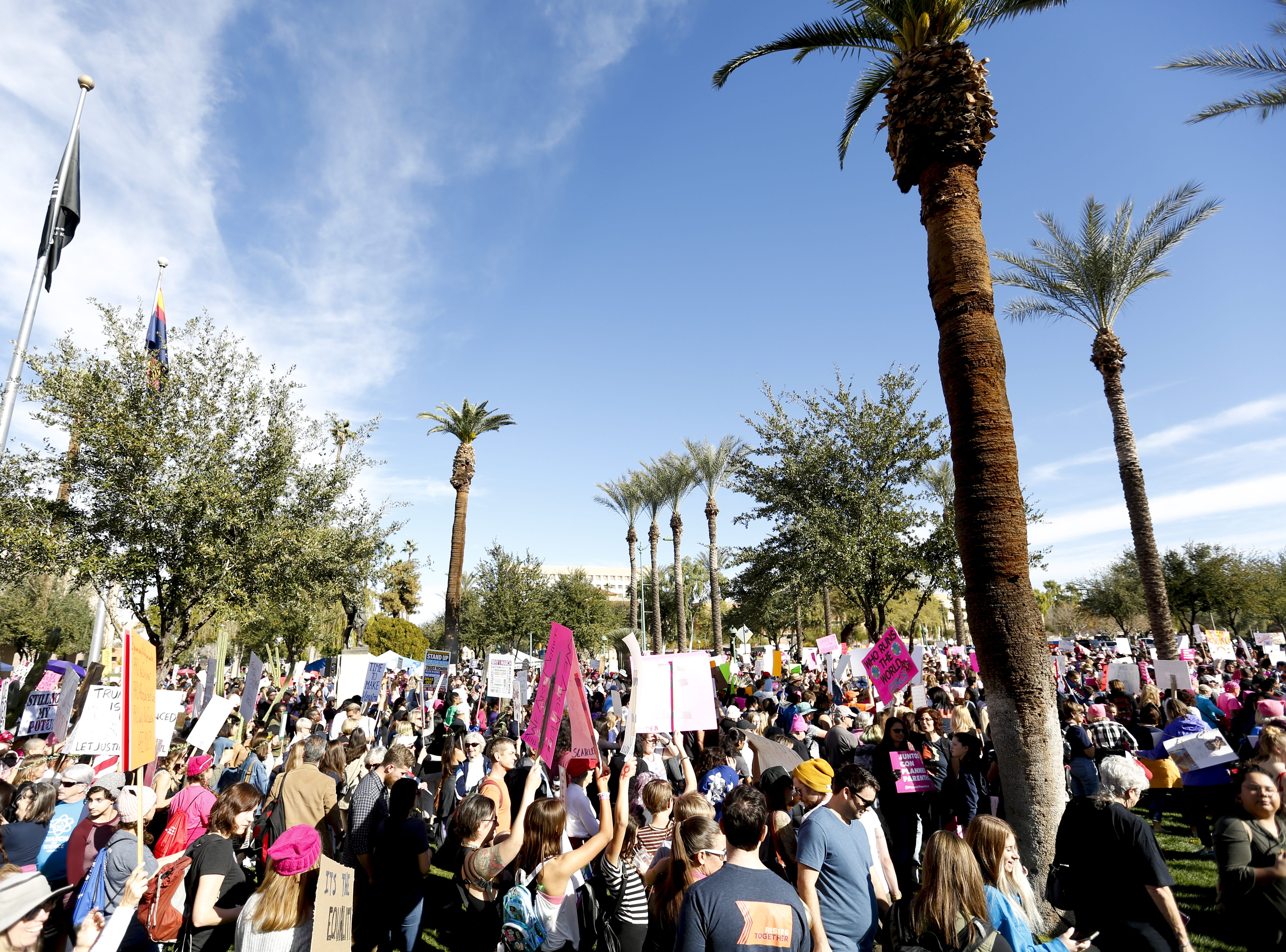 After the speakers finish, the crowd makes its way toward the street to begin marching at Phoenix Women's March on Jan. 19, 2019, at the Arizona Capitol.