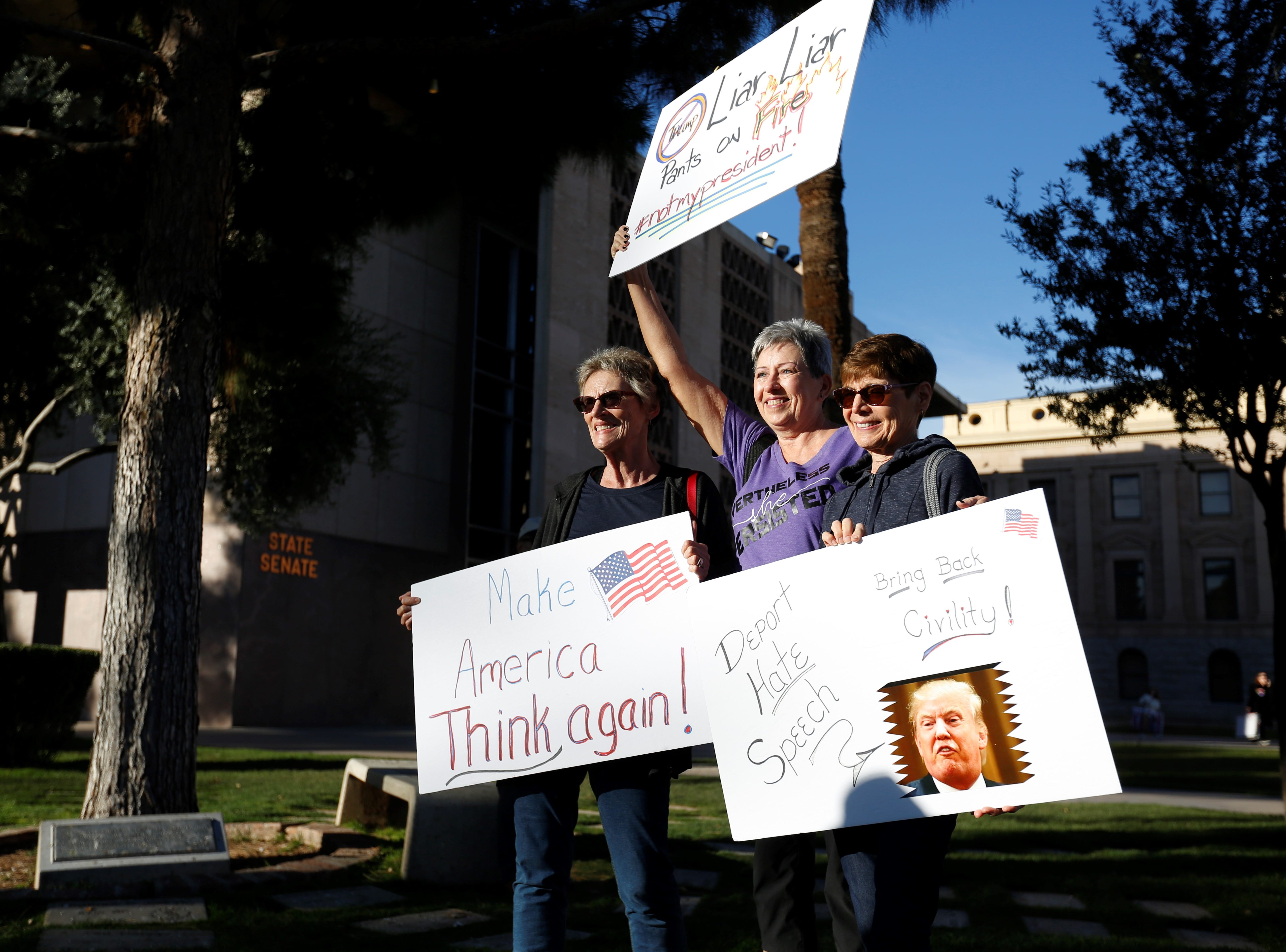 From left: Kathy Callison, Carla Llewellyn and Louise Honikel attend their the Women's March together for the third time at the Arizona Capitol, Jan. 19, 2019.
