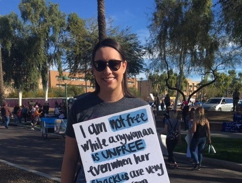 Sarah Delaney, 25, of Phoenix, attends the Women's March starting at the Arizona Capitol, Jan. 29, 2019.