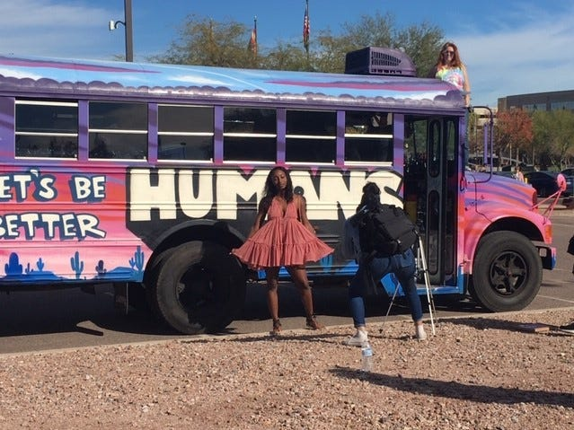Jalyssa Smith of Chandler outside the bus she rode to the Women's March in Phoenix, Jan. 19, 2019.