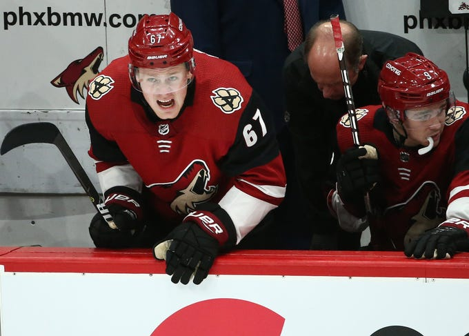 Arizona Coyotes' Lawson Crouse (67) grimaces after being hit with a puck on his lower leg against the Pittsburgh Penguins in the second period on Jan. 18 at Gila River Arena.