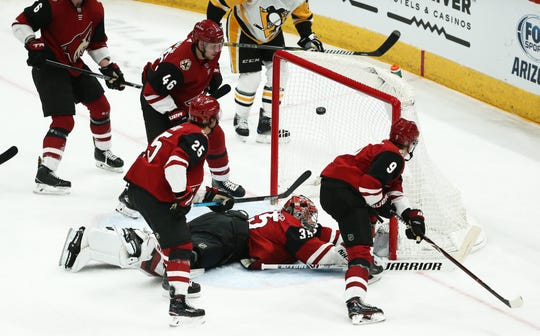 Pittsburgh Penguins' Jake Guentzel (59) skates around the Arizona Coyotes defense and scores a goal in the second period on Jan. 18 at Gila River Arena.