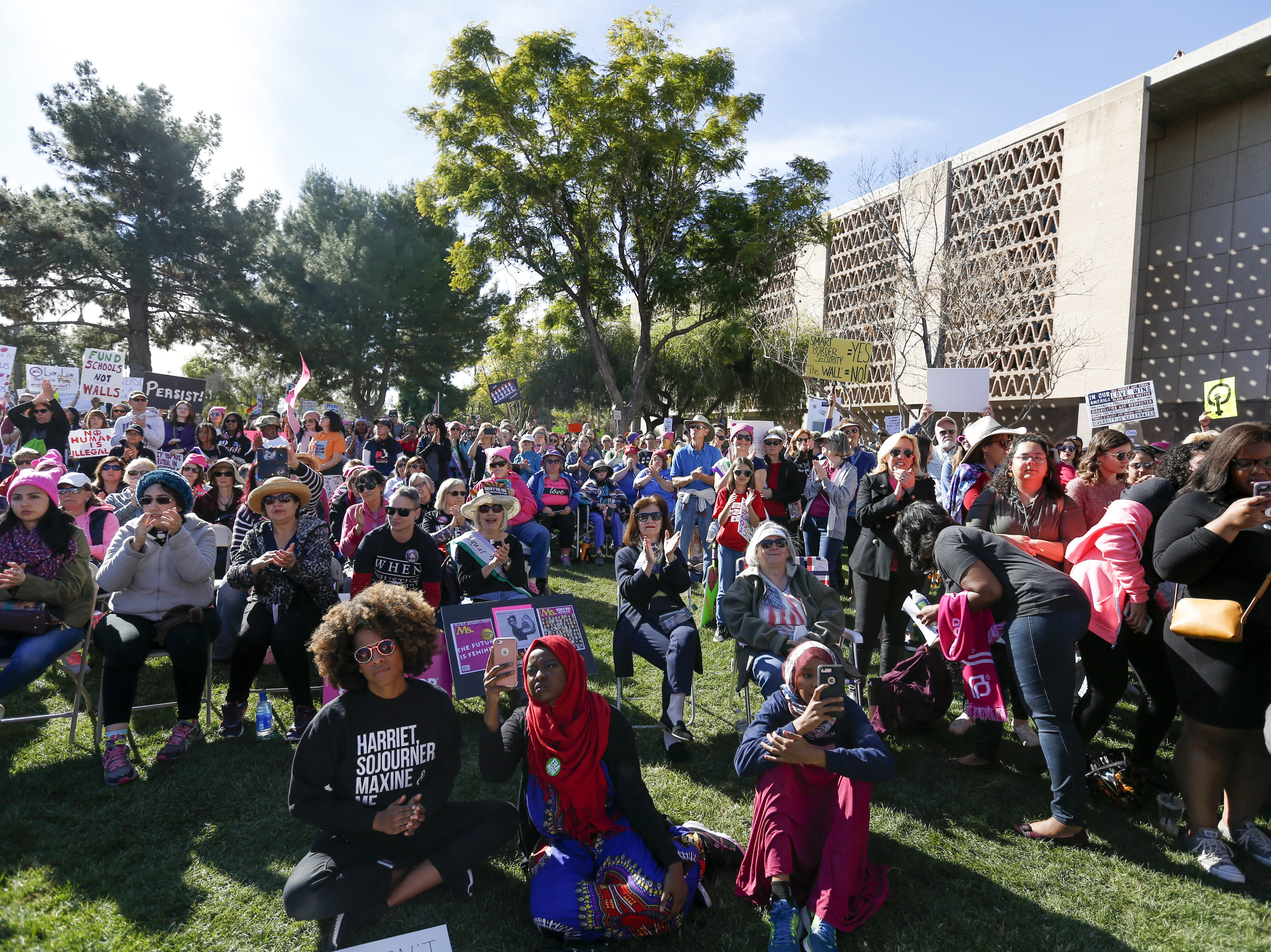 The crowd applauds after the final speaker at the Phoenix Women's March on Jan. 19, 2019, at the Arizona Capitol.