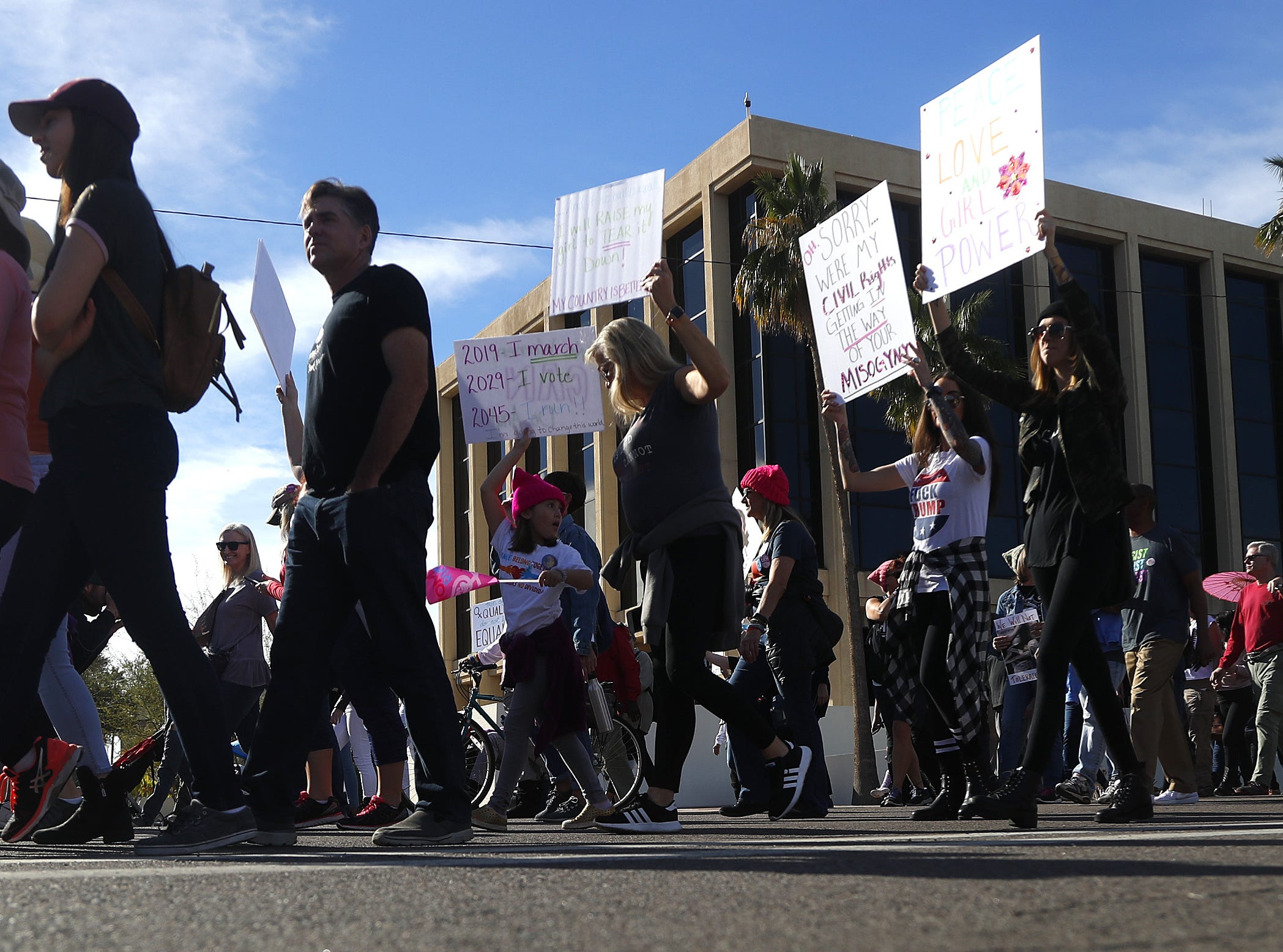 People make their way down Jefferson street during the Women's March outside the Arizona Capitol in Phoenix, Jan. 19, 2019.