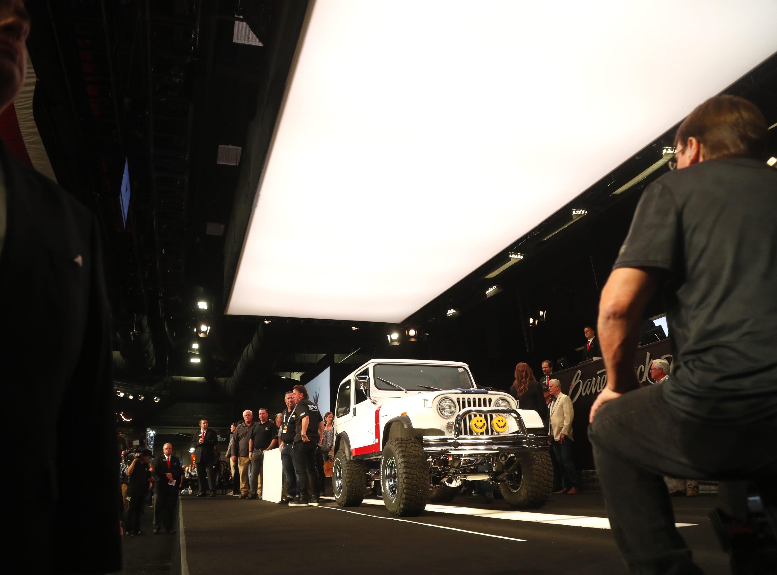 The custom Jeep is brought onstage at Barrett-Jackson.