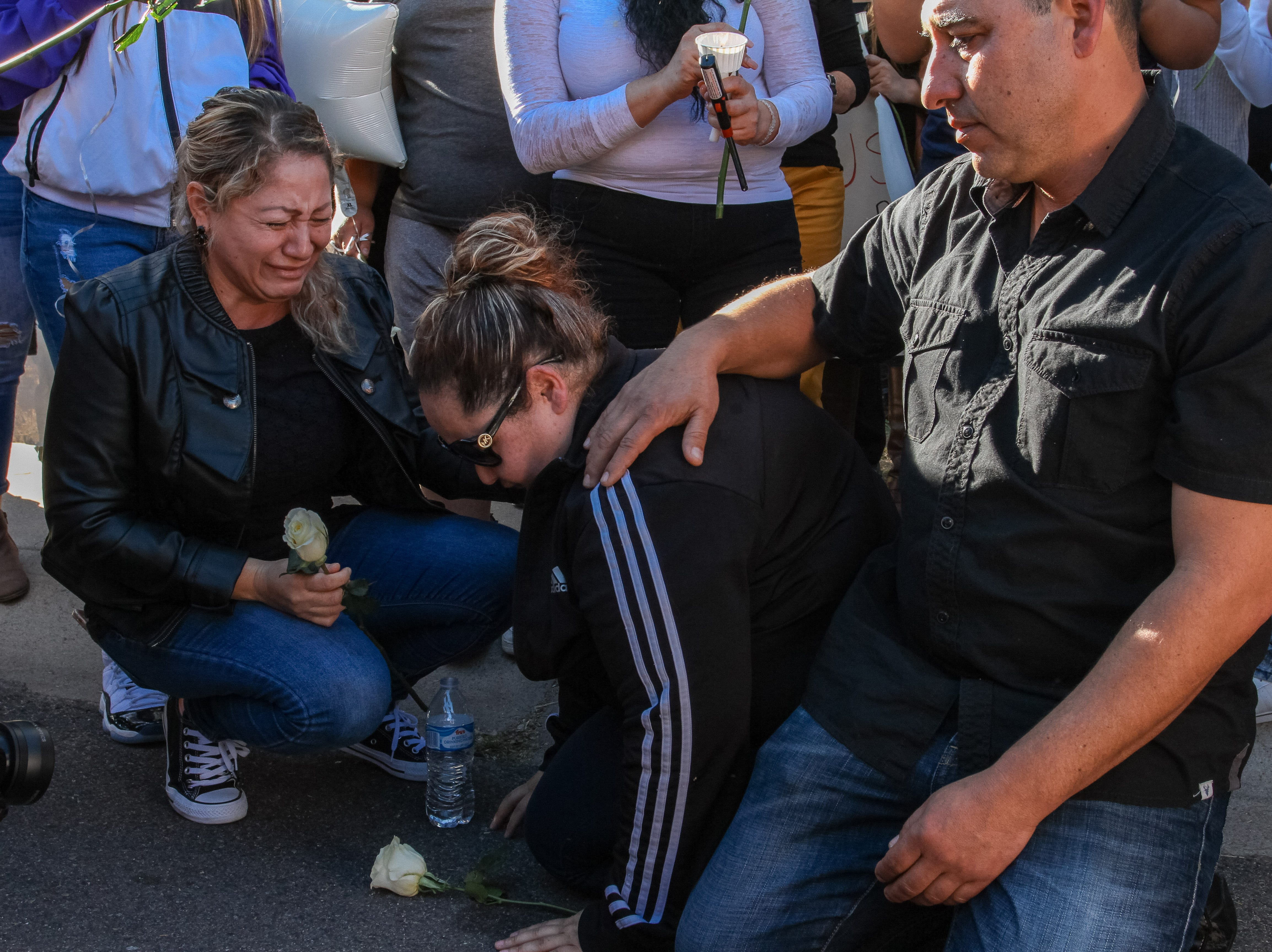 Family and Friends gather together during a vigil on Saturday Jan. 19, 2019 for 14-year-old Antonio who was shot Tuesday afternoon in a residential area north of Baseline Road and east of 48th Street in Tempe.