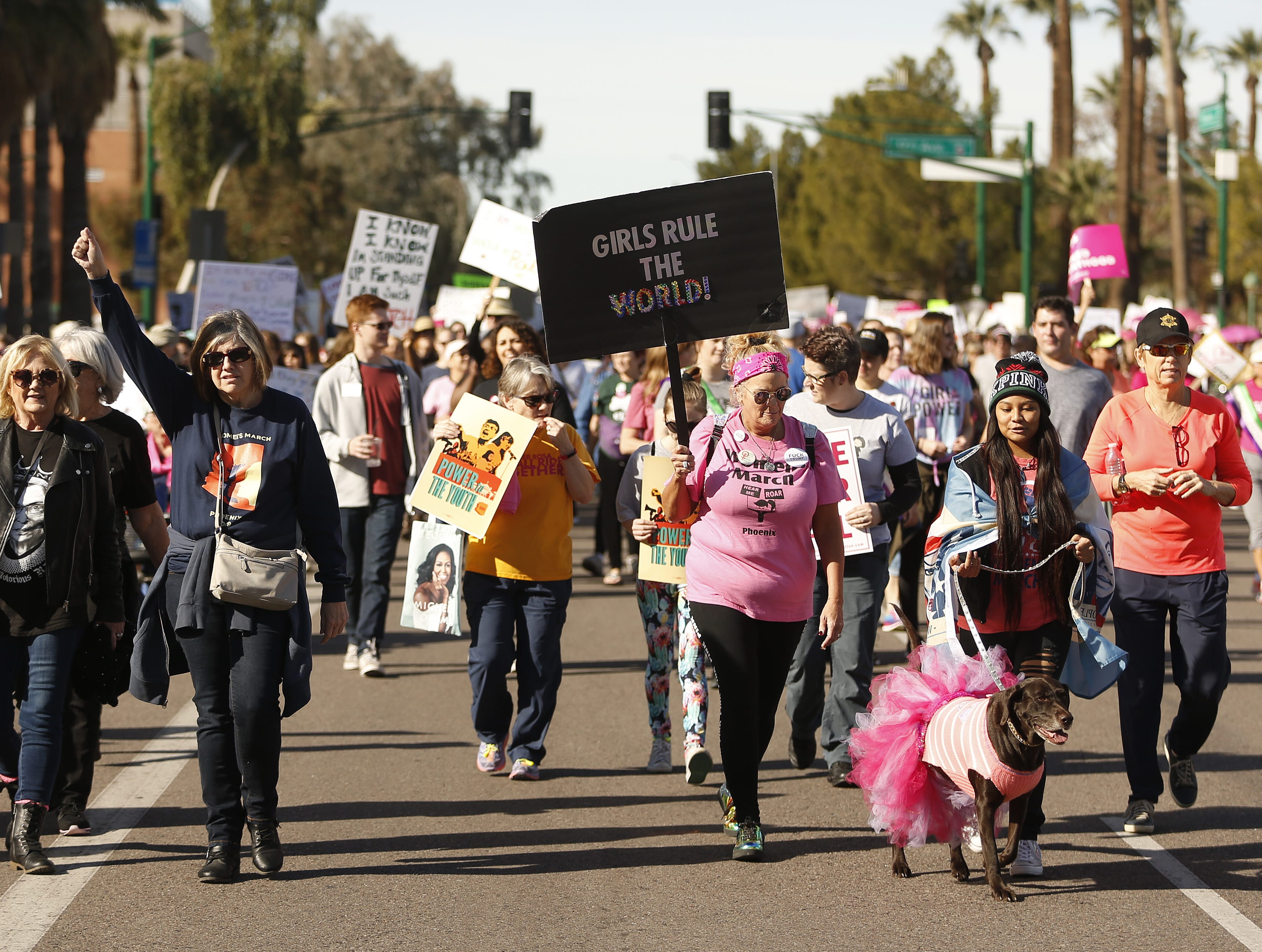 Women take to Jefferson street during the Women's March outside the Arizona Capitol in Phoenix, Jan. 19, 2019.