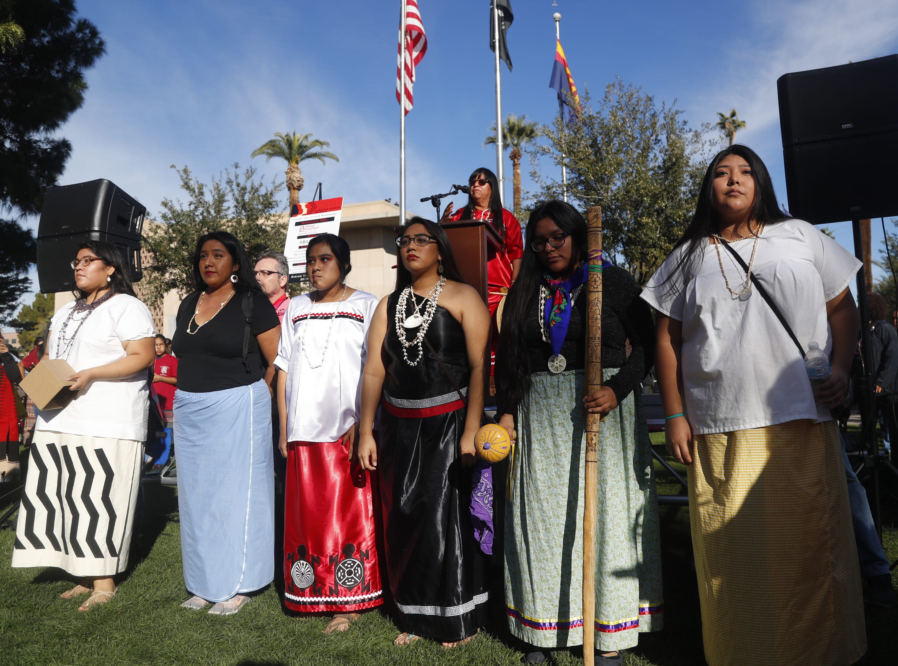 Indigenous women lead off the event with a song lead by Pamela Thompson during the Women's March outside the state capital building in Phoenix, Jan. 19, 2019.