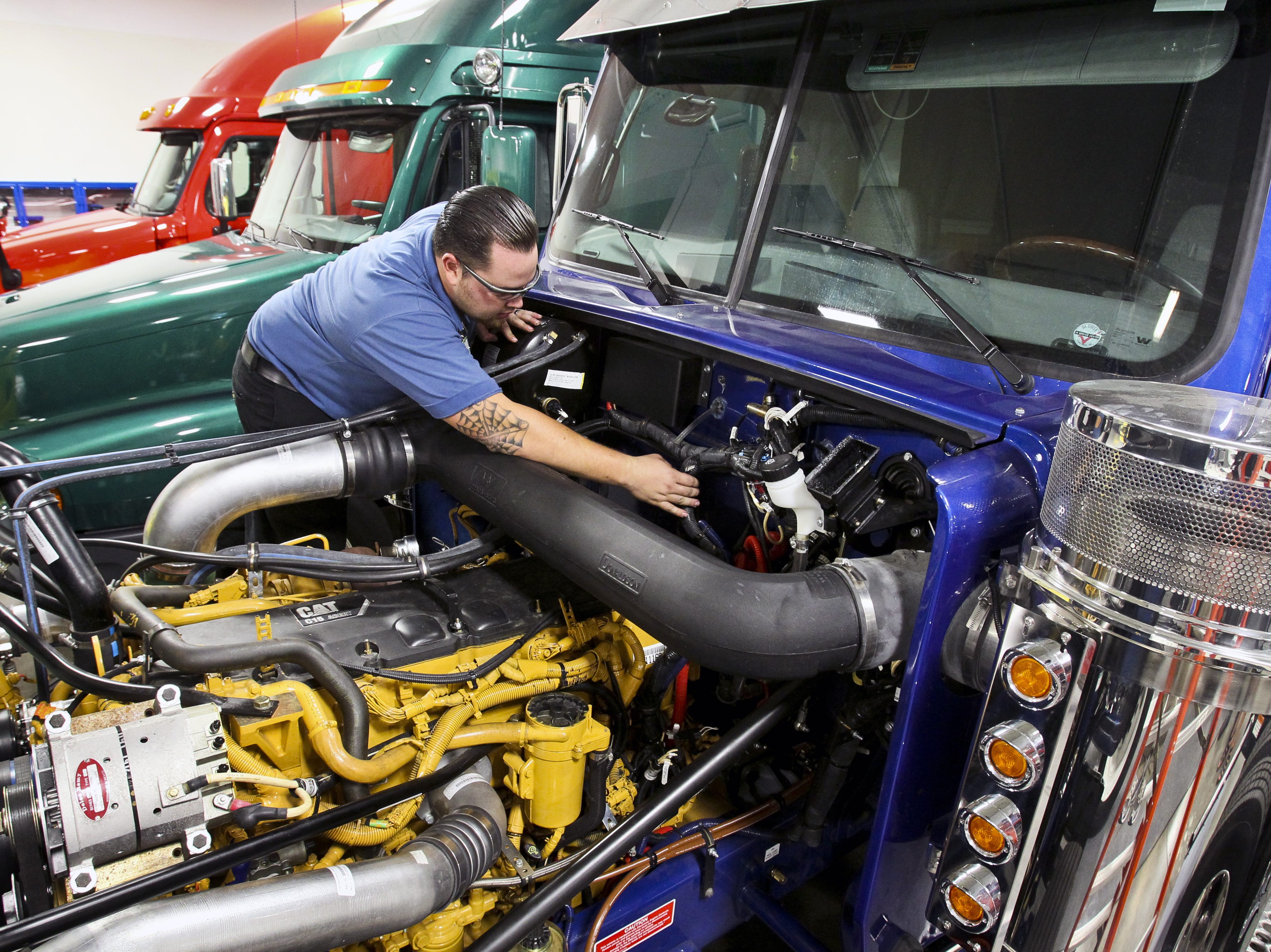Michael Jager of Surprise learns to diagnose problems in and repair Freightliner, Sterling and Western Star trucks at the Universal Technical Institute in Avondale on Aug. 3, 2010.