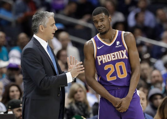 Phoenix Suns coach Igor Kokoskov, left, talks with Josh Jackson during the first half of the team's NBA basketball game against the Charlotte Hornets in Charlotte, N.C., Saturday, Jan. 19, 2019. (AP Photo/Chuck Burton)