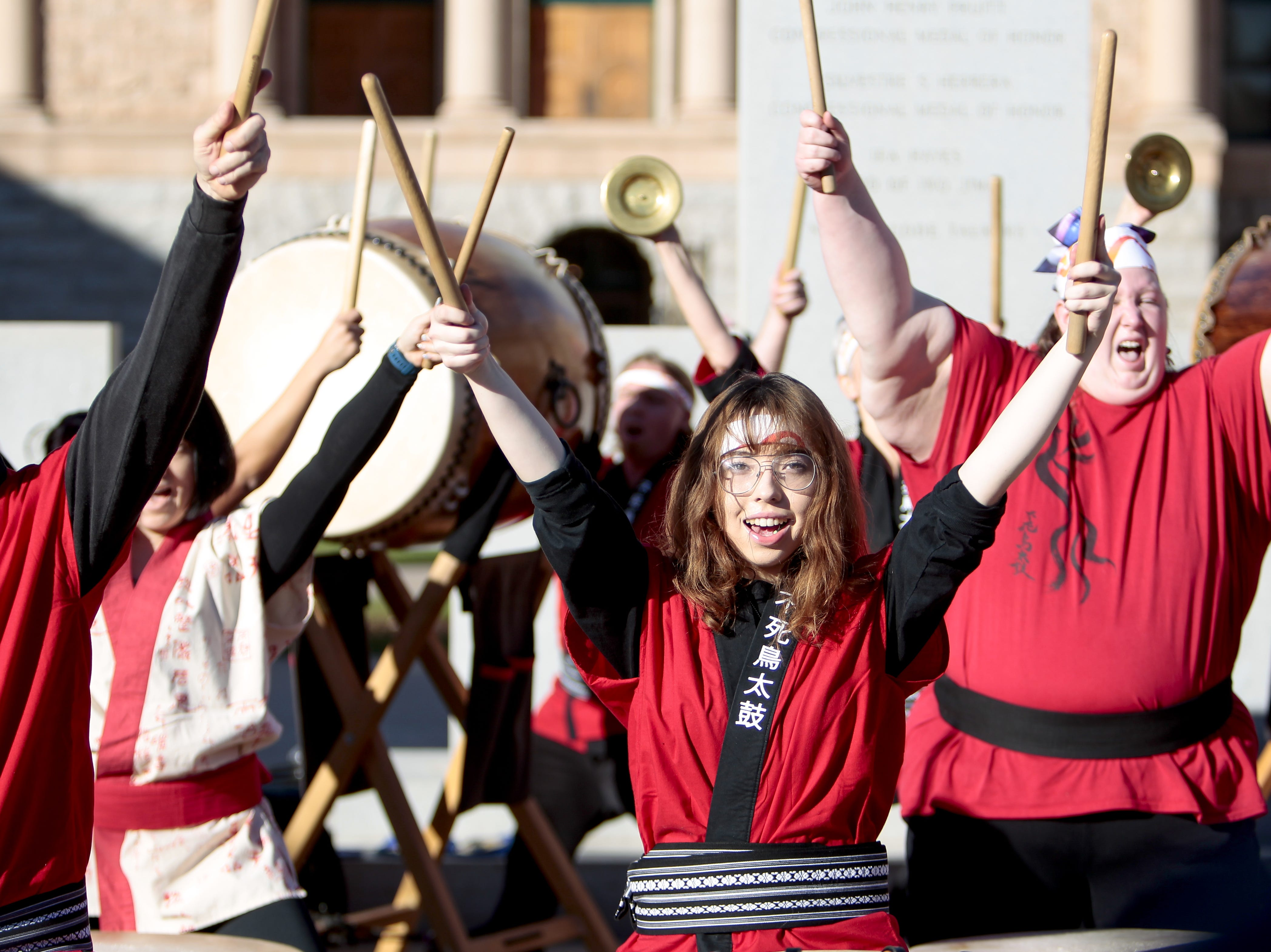 Sammie Barnes, 17, performs with the Fushiko Daiko Dojo at the Phoenix Women's March on Jan. 19, 2019, at the Arizona Capitol.