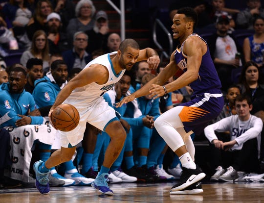 Suns rookie Elie Okobo used to get up early on Saturday mornings in France to watch Tony Parker play.