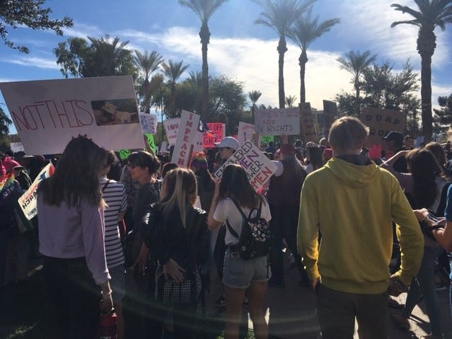Marchers line up outside the Arizona Capitol to walk Women's March route, Jan. 19, 2019.