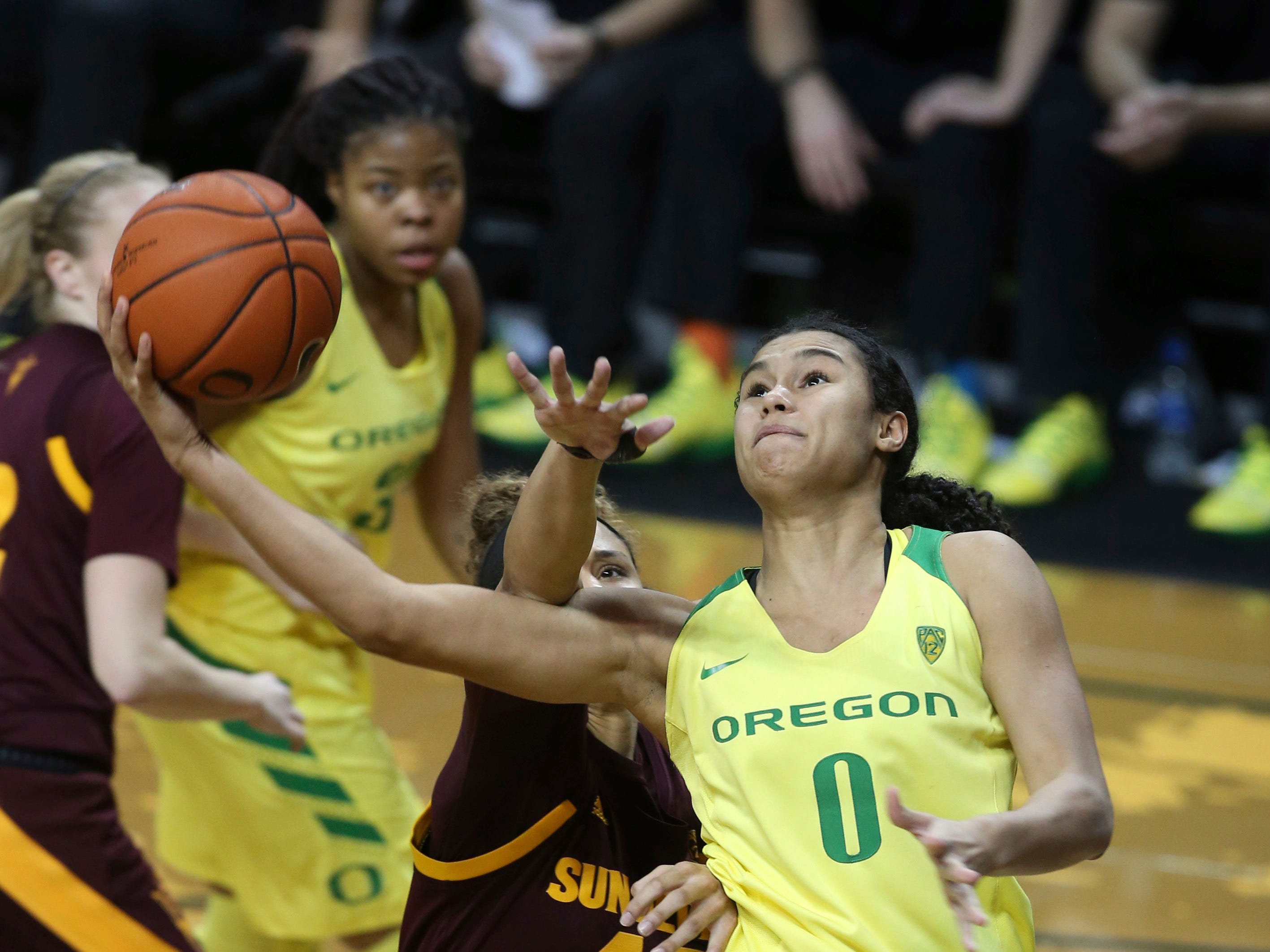 Oregon's Satou Sabally, right, goes up for a shot ahead of Arizona State's Courtney Ekmark, left, Oregon's Oti Gildon and Arizona State's Kianna Ibis during the fourth quarter of an NCAA college basketball game Friday, Jan. 18, 2019, in Eugene, Ore. (AP Photo/Chris Pietsch)
