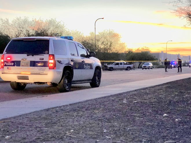 Police vehicles gather near the site of a serious collision Friday afternoon involving a semitruck and another vehicle that shut a stretch of Buckeye Road in west Phoenix.