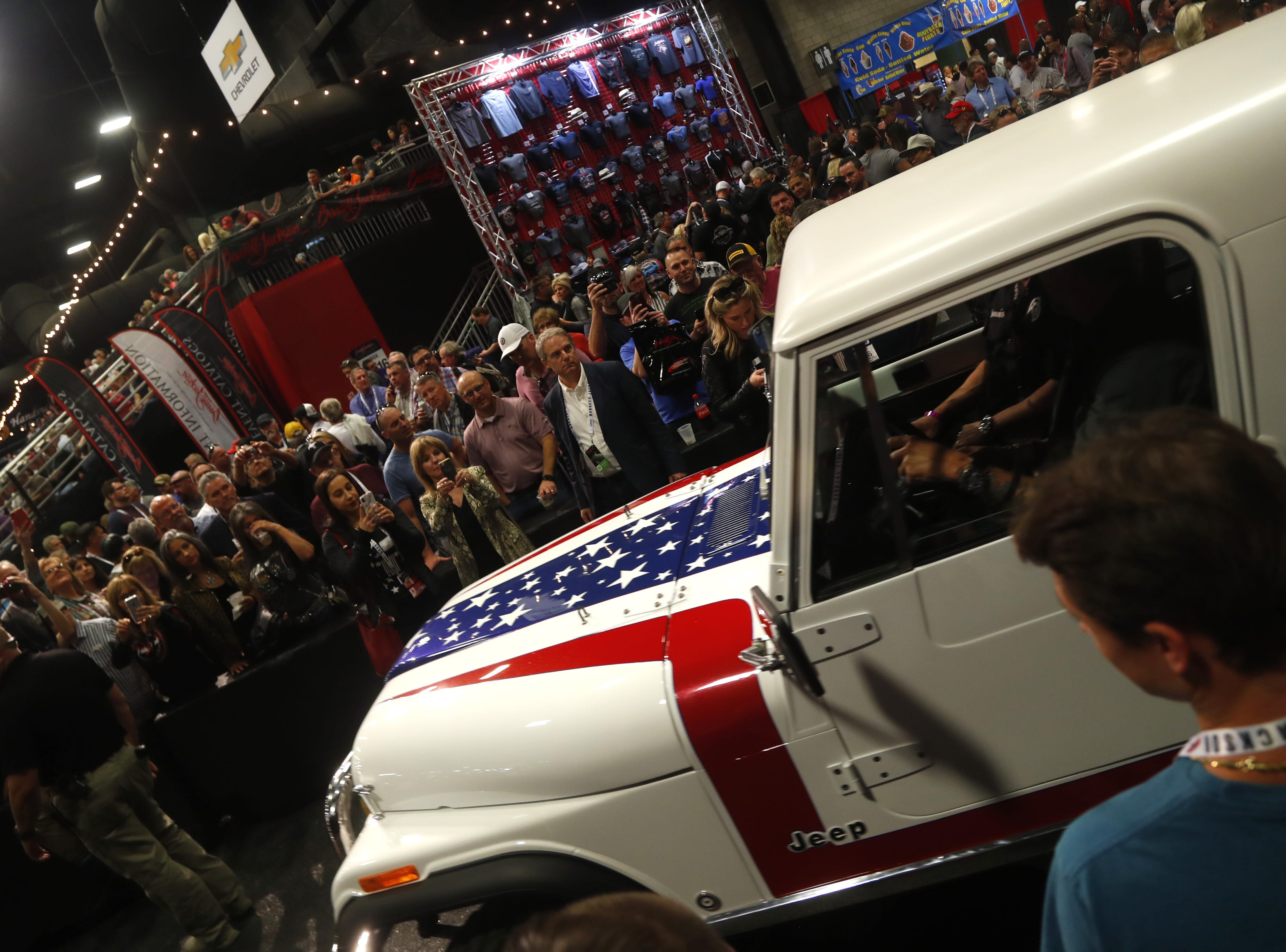 The custom Jeep restored by Gas Monkey Garage in partnership with Gary Sinise and being auctioned off for the Gary Sinise Foundation is brought onstage at the Barrett-Jackson auction at WestWorld in Scottsdale on Jan. 18, 2019.