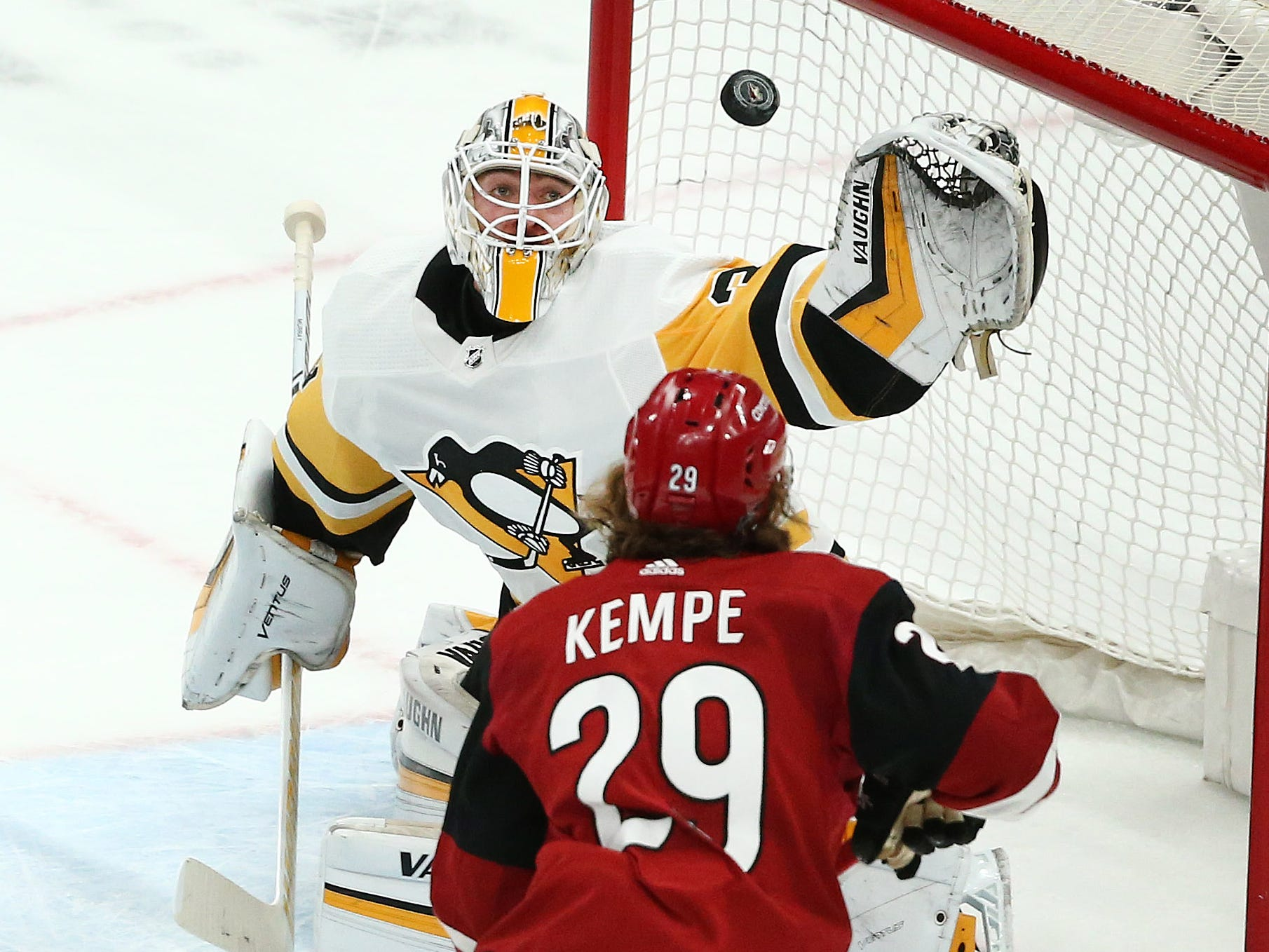 Pittsburgh Penguins goalie Matt Murray catches the shot by the Arizona Coyotes in the first period on Jan. 18 at Gila River Arena.