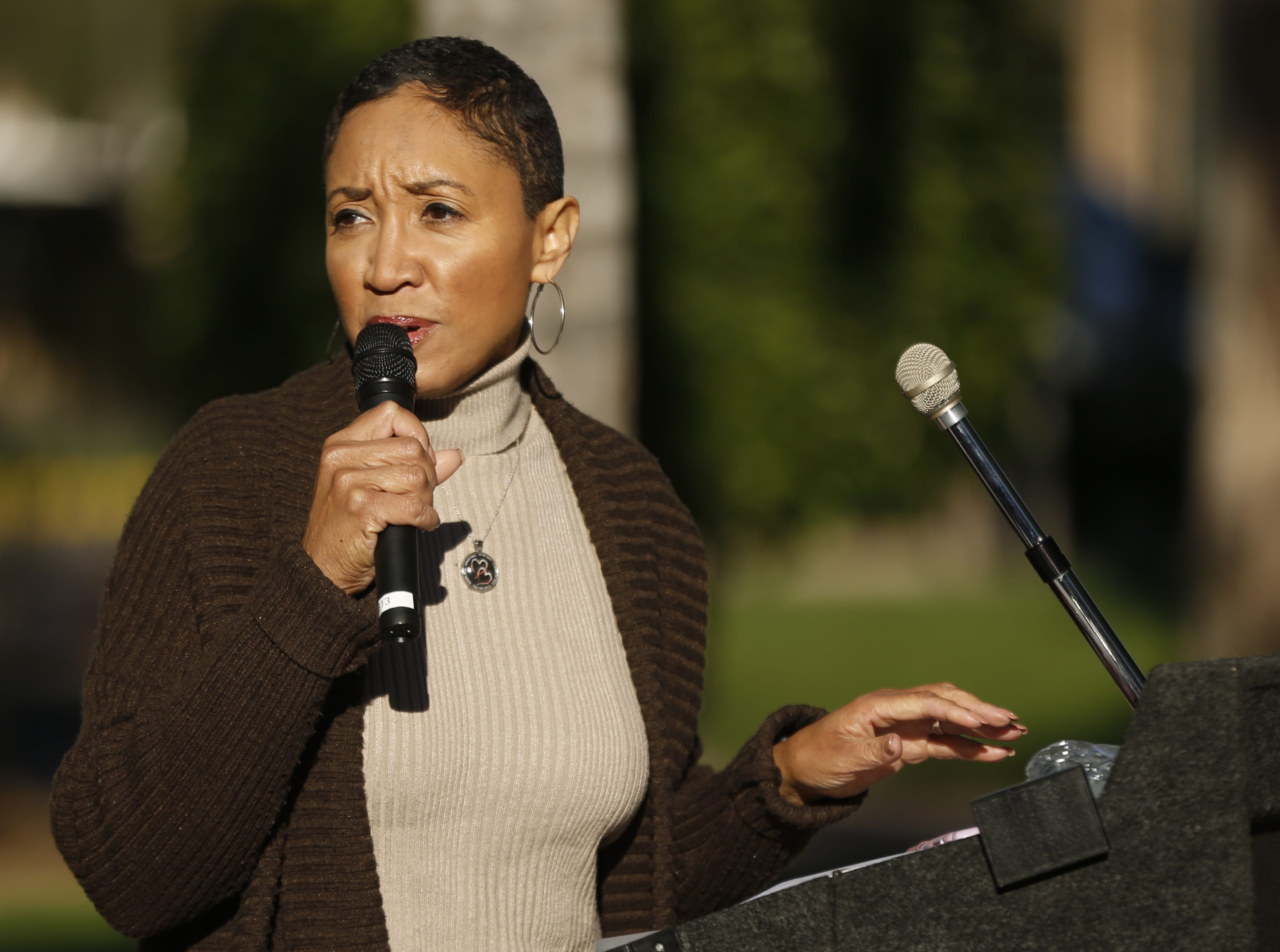 Janelle Wood speaks during a gathering for the Black Women's March before the start of the Women's March outside the Arizona Capitol in Phoenix, Ariz. on January 19, 2019.