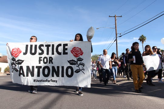 Hundreds of people walk through the neighborhood where 14-year-old Antonio Arce was shot by a Tempe police officer earlier this week. The walk part of a vigil held for the boy.