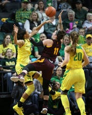 Oregon's Satou Sabally, left, blocks a shot by Arizona State's Robbi Ryan during the first half of an NCAA college women's basketball game Friday, Jan. 18, 2019, in Eugene, Ore. (AP Photo/Chris Pietsch)