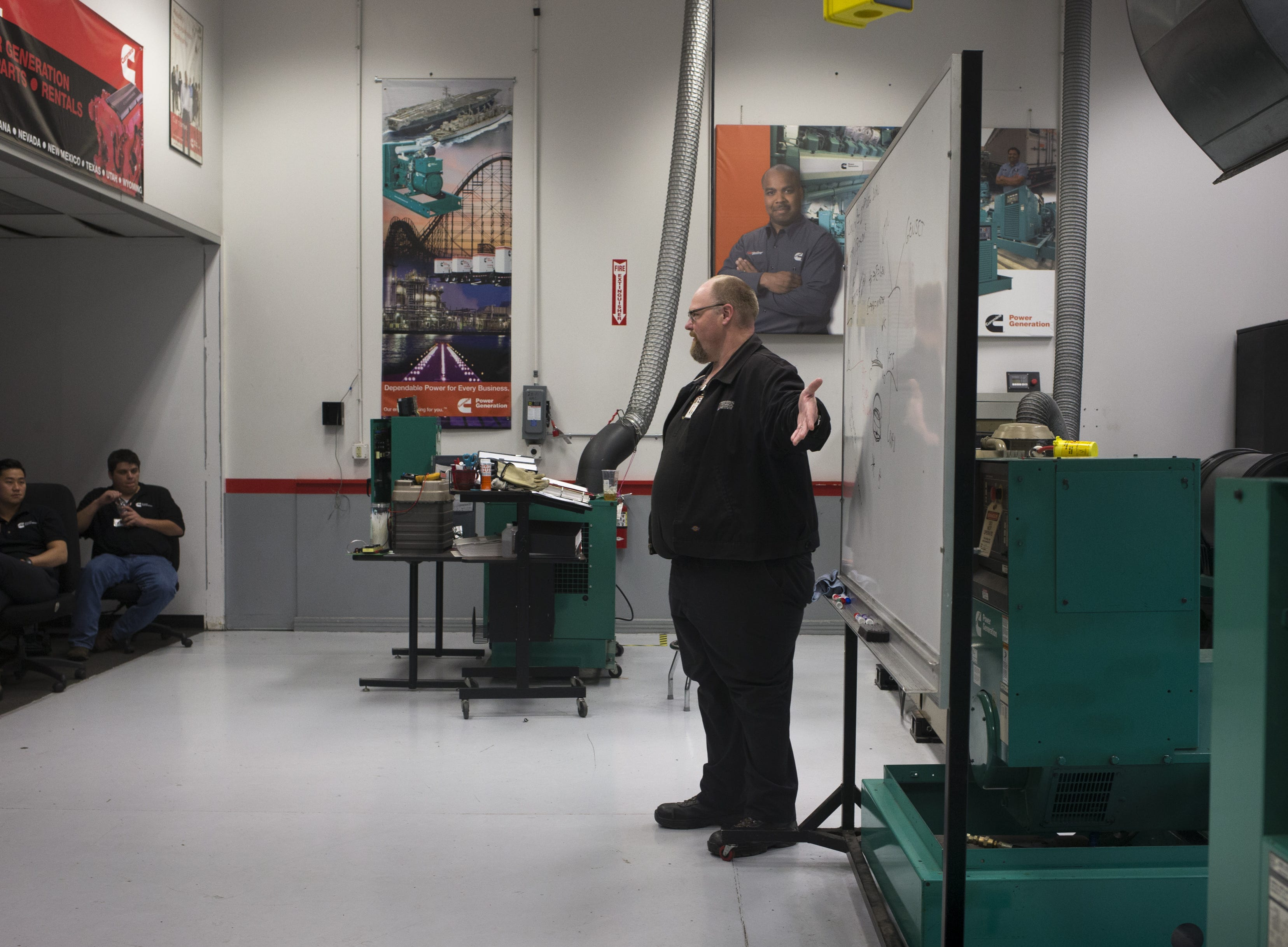 Jason Mosler teaches students in the generator lab, Jan. 17, 2019, at the Universal Technical Institute, 10695 W. Pierce St., Avondale.