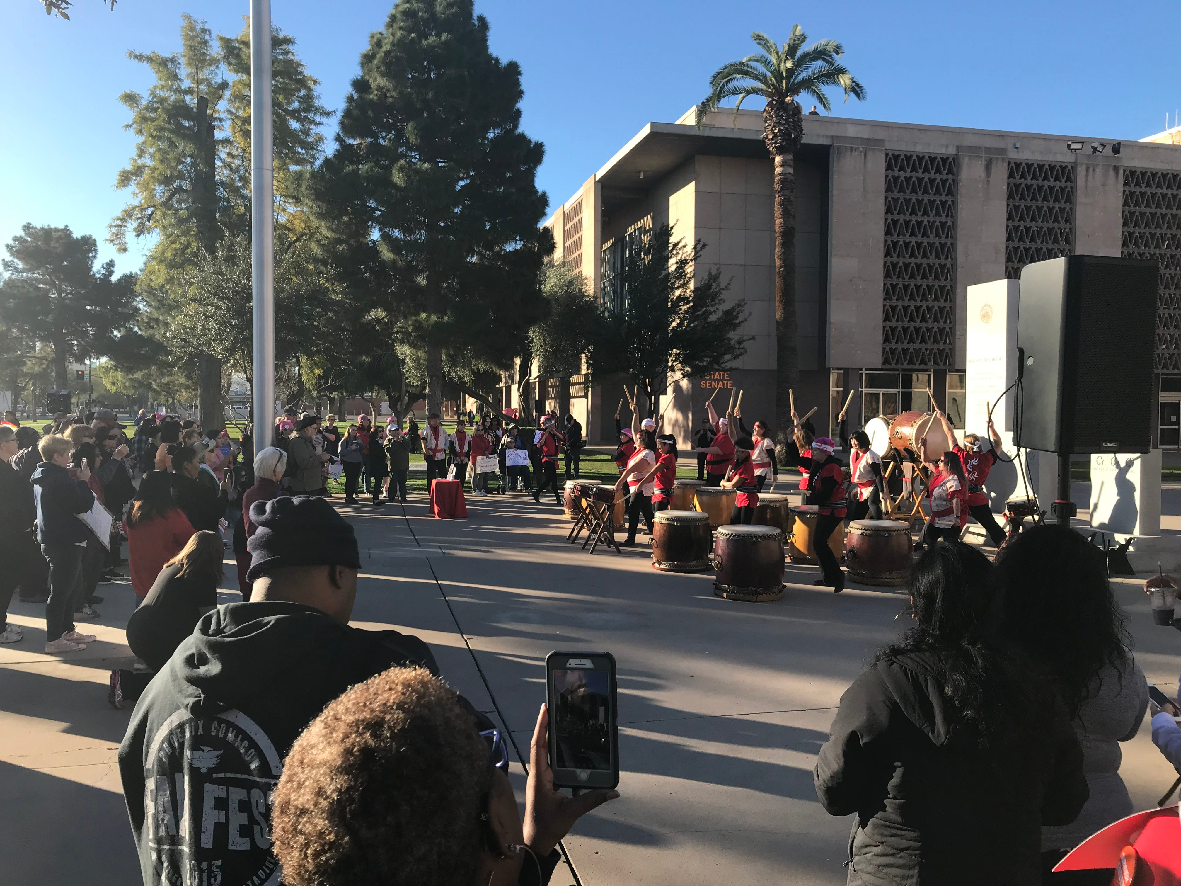 People gather at the Arizona Capitol in downtown Phoenix before the 2019 Women's March. Japanese Taiko drumming kicks off the event, Jan. 19, 2019.