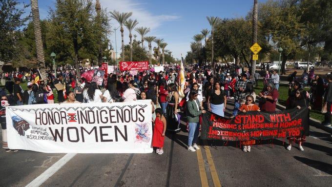 Indigenous women lead off the Women's March outside the Arizona Capitol in Phoenix, Jan. 19, 2019.