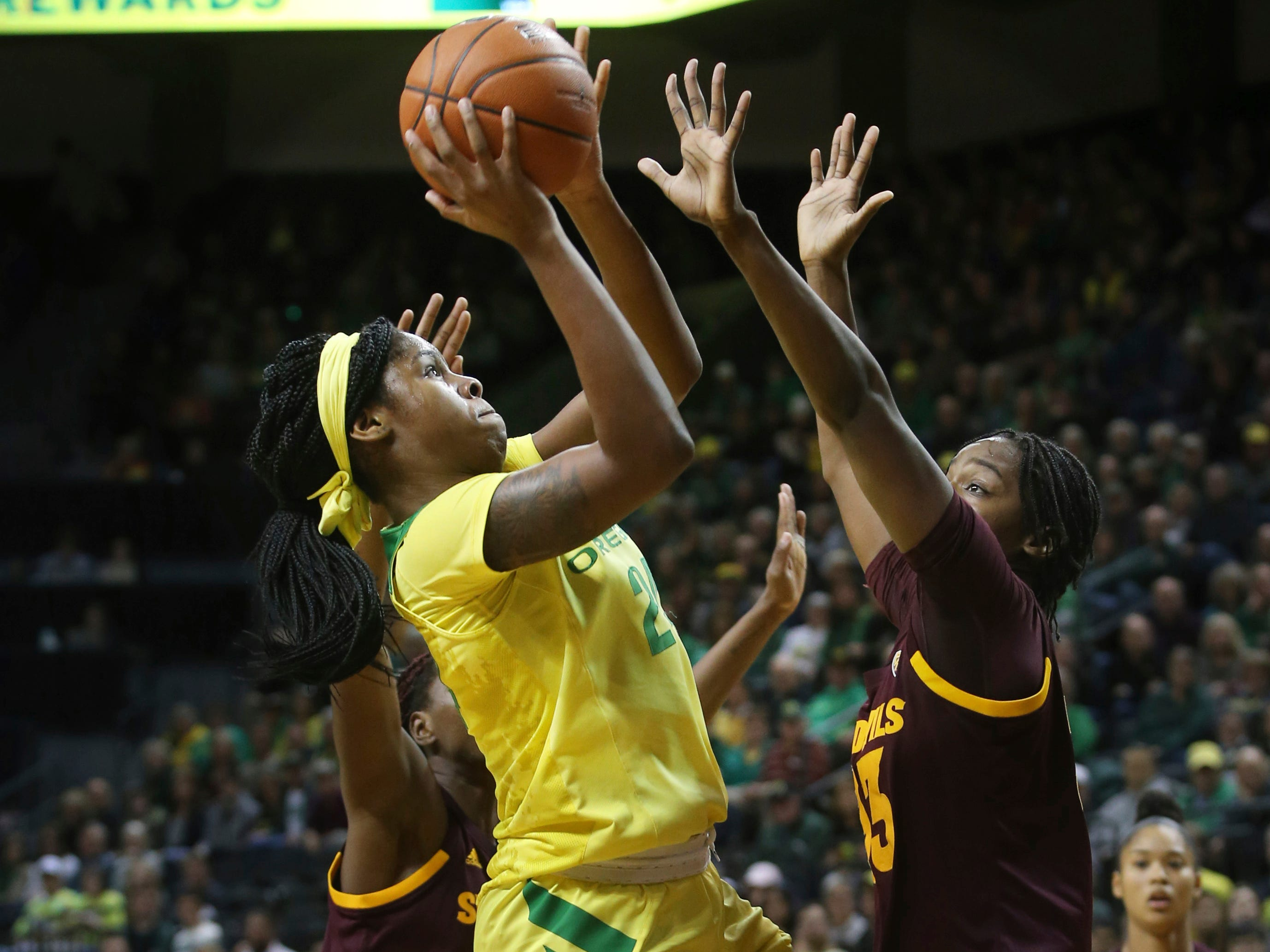 Oregon's Ruthy Hebard, center, shoots between Arizona State's Sophia Elenga, left, and Charnea Johnson-Chapman during the first quarter of an NCAA college basketball game Friday, Jan 18, 2019, in Eugene, Ore. (AP Photo/Chris Pietsch)