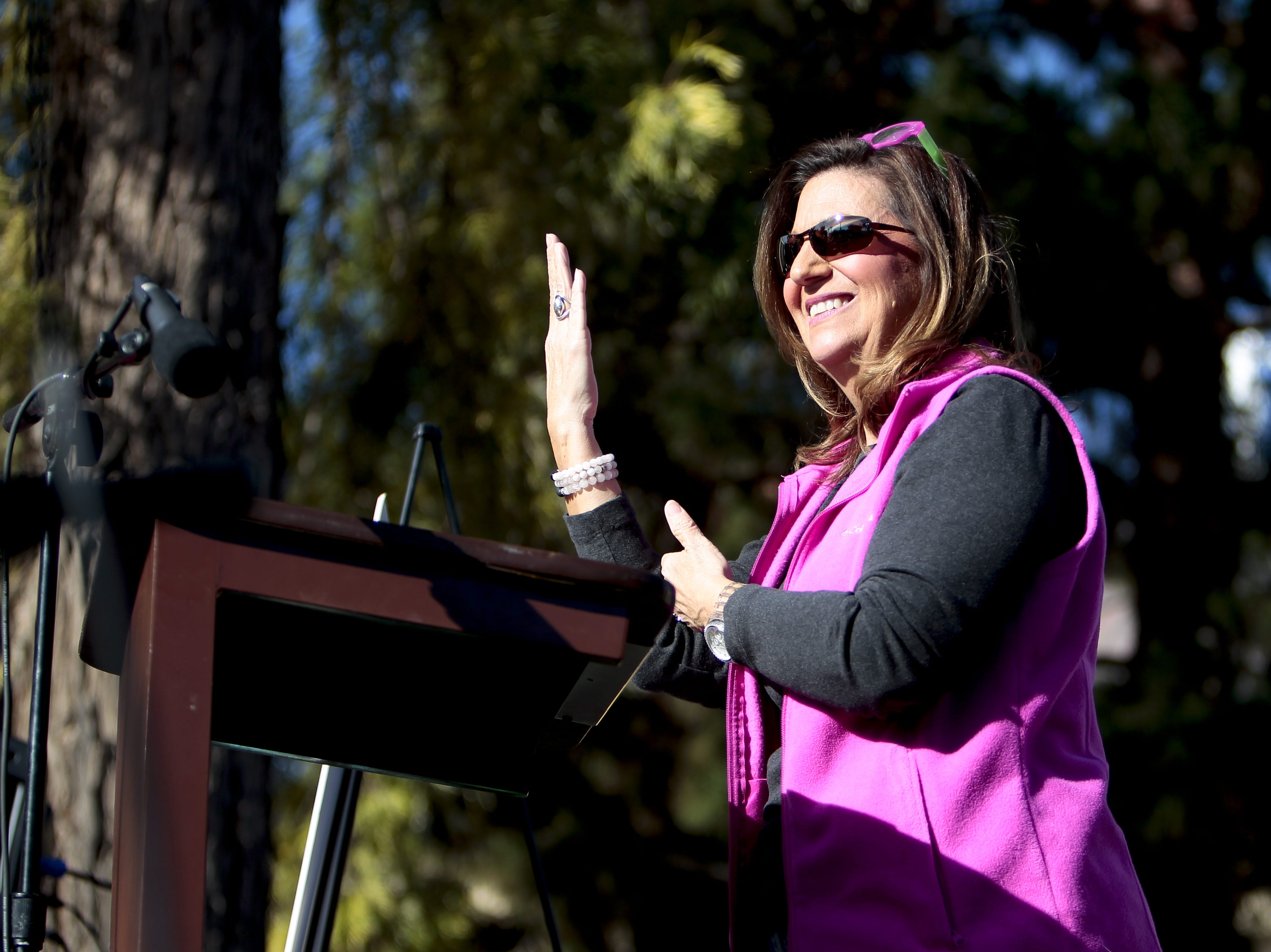 Sherri Collins, the executive director of the Arizona Commission for the Deaf and Hard of Hearing at the Phoenix Women's March on Jan. 19, 2019, at the Arizona Capitol. The speech was delivered in sign language and interpreted for the rest of the crowd.
