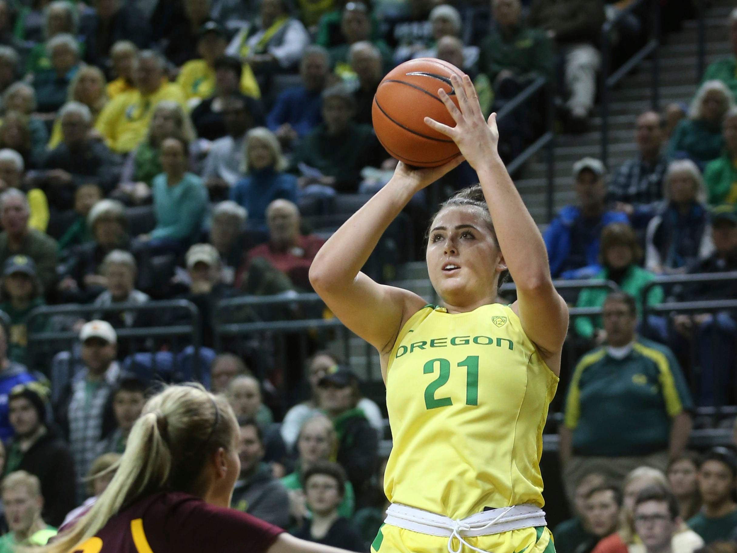 Oregon's Erin Boley, right, shots over Arizona State's Courtney Ekmark during the second quarter of an NCAA college basketball game Friday, Jan 18, 2019, in Eugene, Ore. (AP Photo/Chris Pietsch)