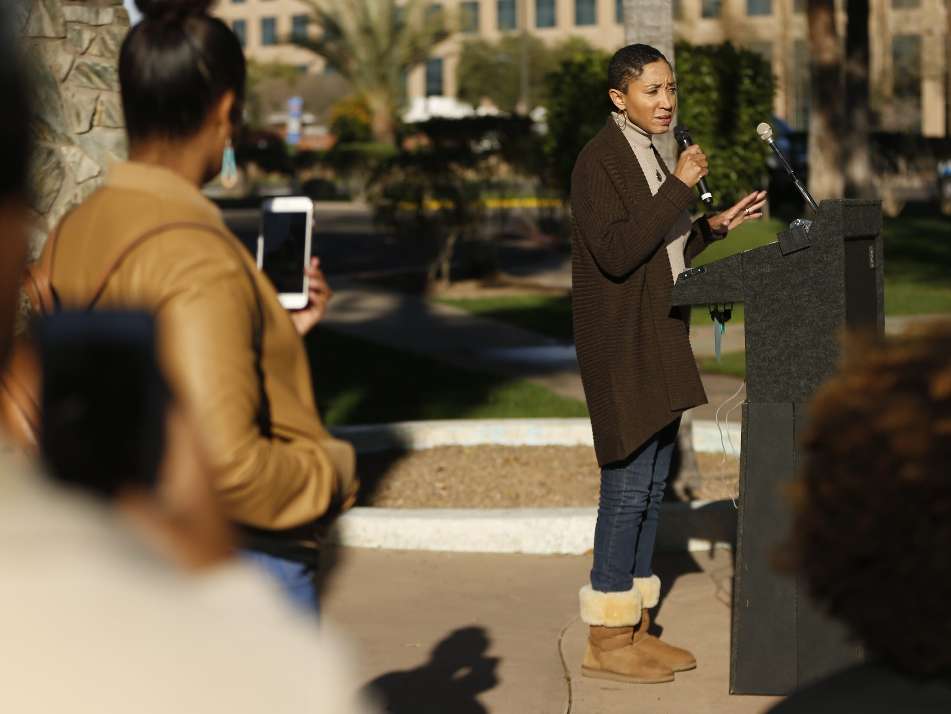 Janelle Wood speaks during a gathering for the Black Women's March before the start of the Women's March outside the Arizona Capitol in Phoenix, Jan. 19, 2019.