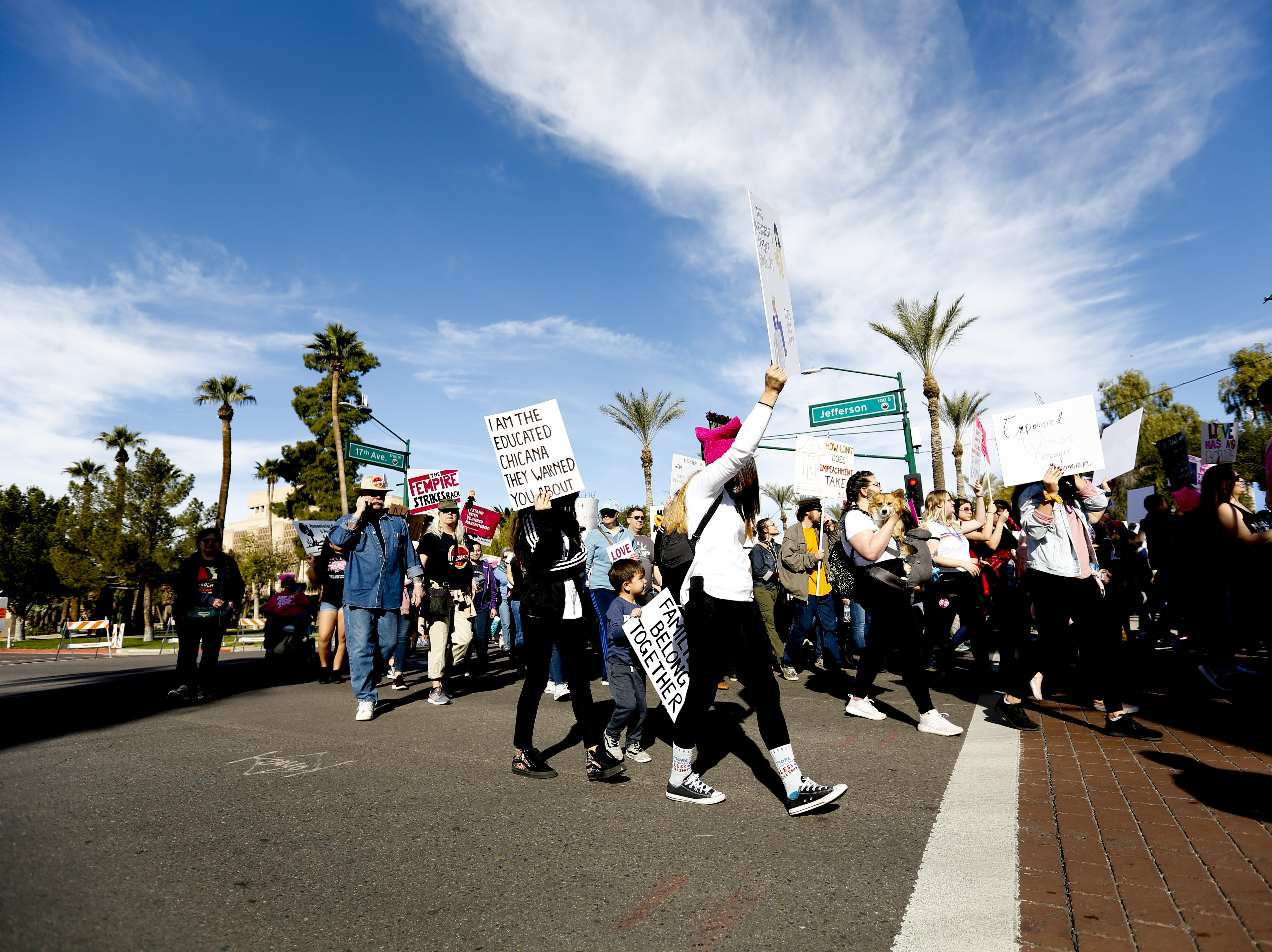 Women's March participants round a corner during the Jan. 19, 2019, march at the Arizona Capitol.