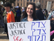 Julia Lange, who is Jewish, attended the Phoenix Women's March in 2019 despite accusations of anti-Semitism leveled at national march organizers. Her sign is written in English and Hebrew.