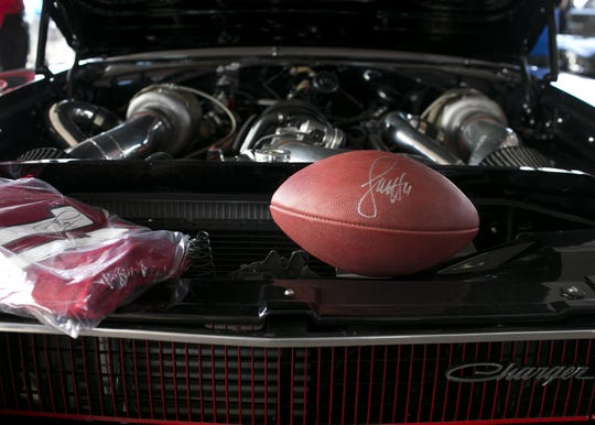 Cardinals Wide Receiver Larry Fitzgerald's custom built turbo-paired engined 1968 Charger is auctioned at Barrett-Jackson collector-car auction for $100,000 at WestWorld on Sat. January 19, 2019 a in Scottsdale, Ariz.