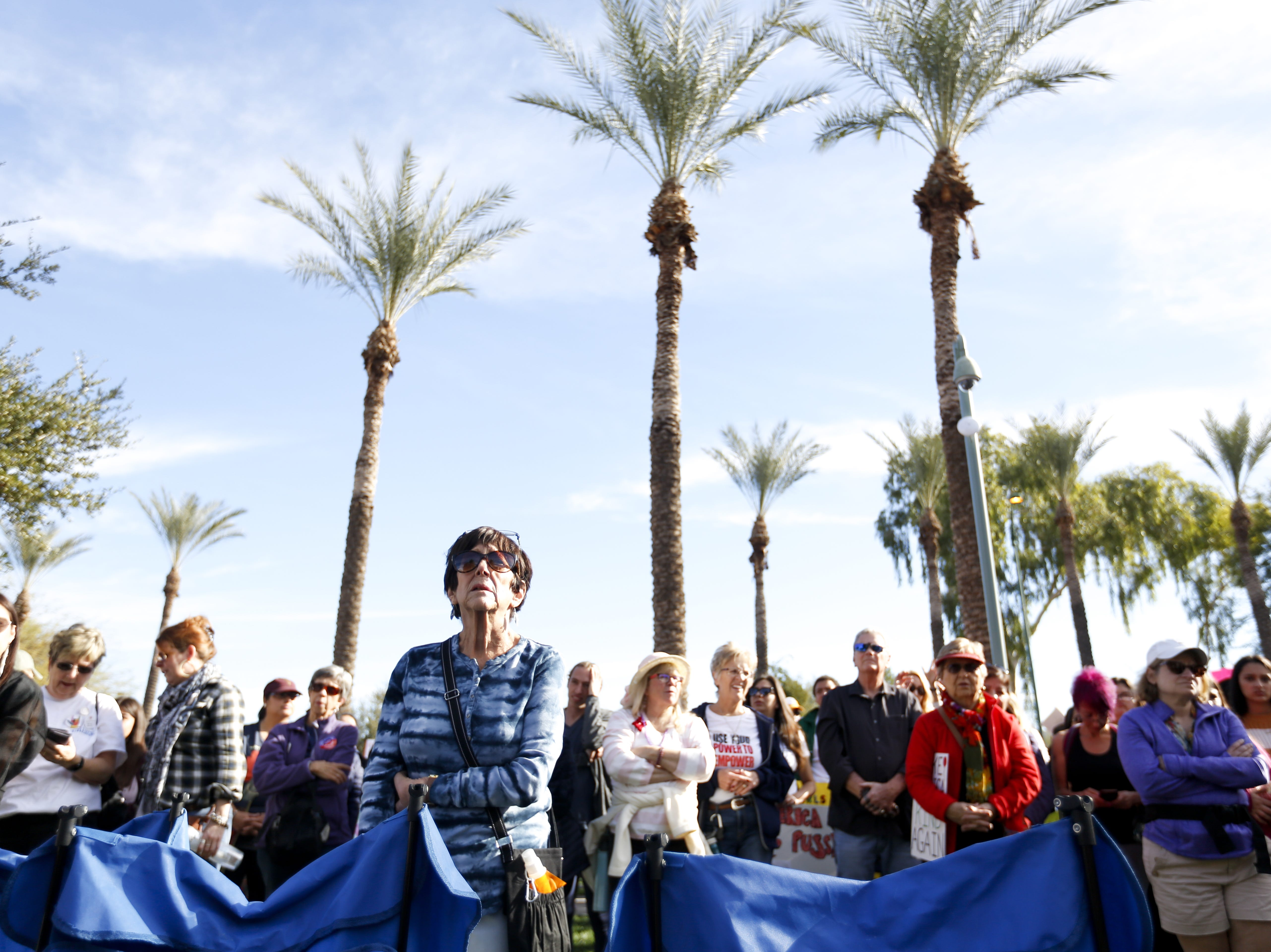 The crowd listens to the interpretation of Sherri Collins' speech at the Phoenix Women's March on Jan. 19, 2019, at the Arizona Capitol.