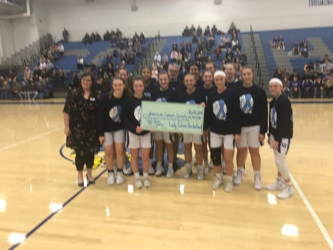 The Cedar Crest girls basketball team presented a check for $2703 to Marissa Curtiss of the American Cancer Society on Friday night prior to the Falcons' game vs. Manheim Township. The money was raised through the team's Foul Shots for Cancer fundraising effort.  The Falcons came up big during the game, too, winning the key Section 1 matchup.