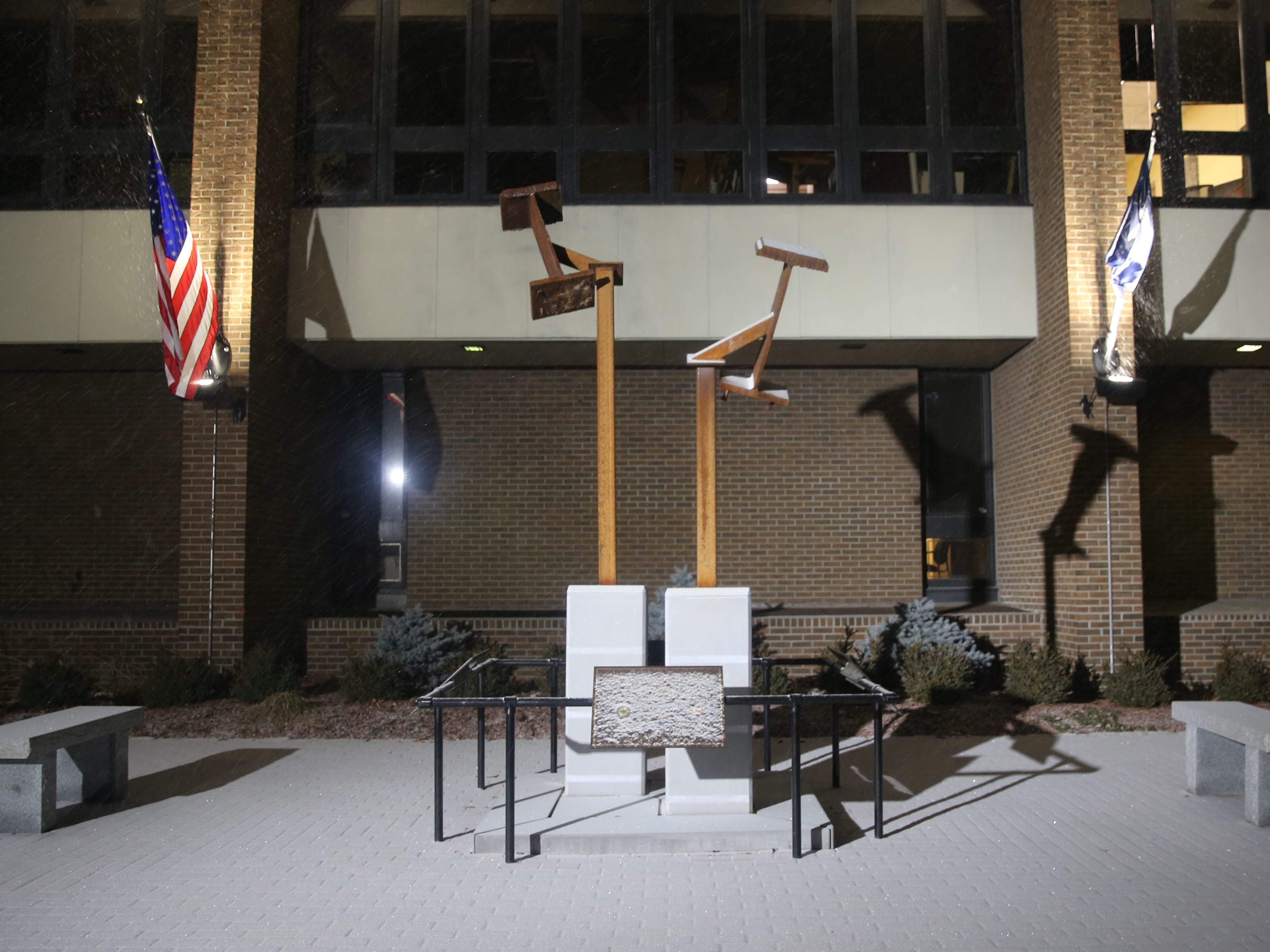 Snow falls and covers part of the ground in front of Poughkeepsie City Hall on Saturday at around 6:30 p.m. The snow is predicted to be heaviest between 8 and 10 p.m., according to the National Weather Service in Albany.