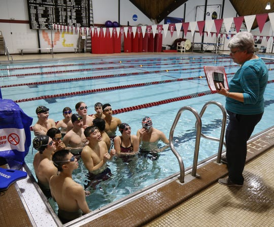 Arlington swimming team assistant coach Pam Terwilliger speaks to the team during practice at Vassar College on January 18, 2019.