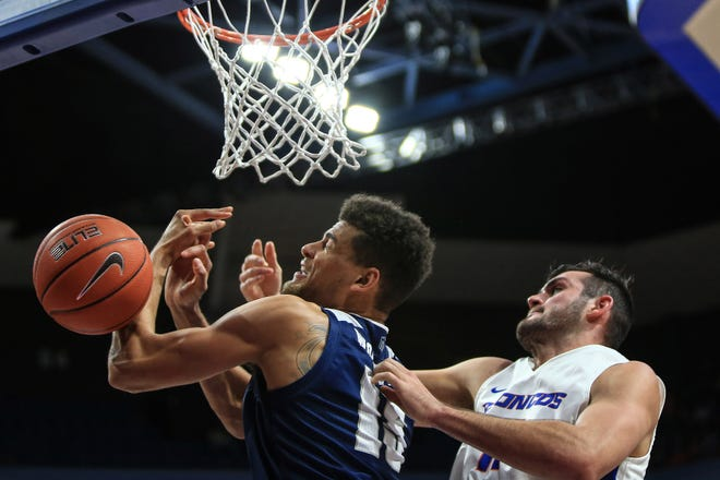 Nevada's Trey Porter (15) and Boise State's Zach Haney fight for a rebound during the Wolf Pack's win in Boise earlier this season.