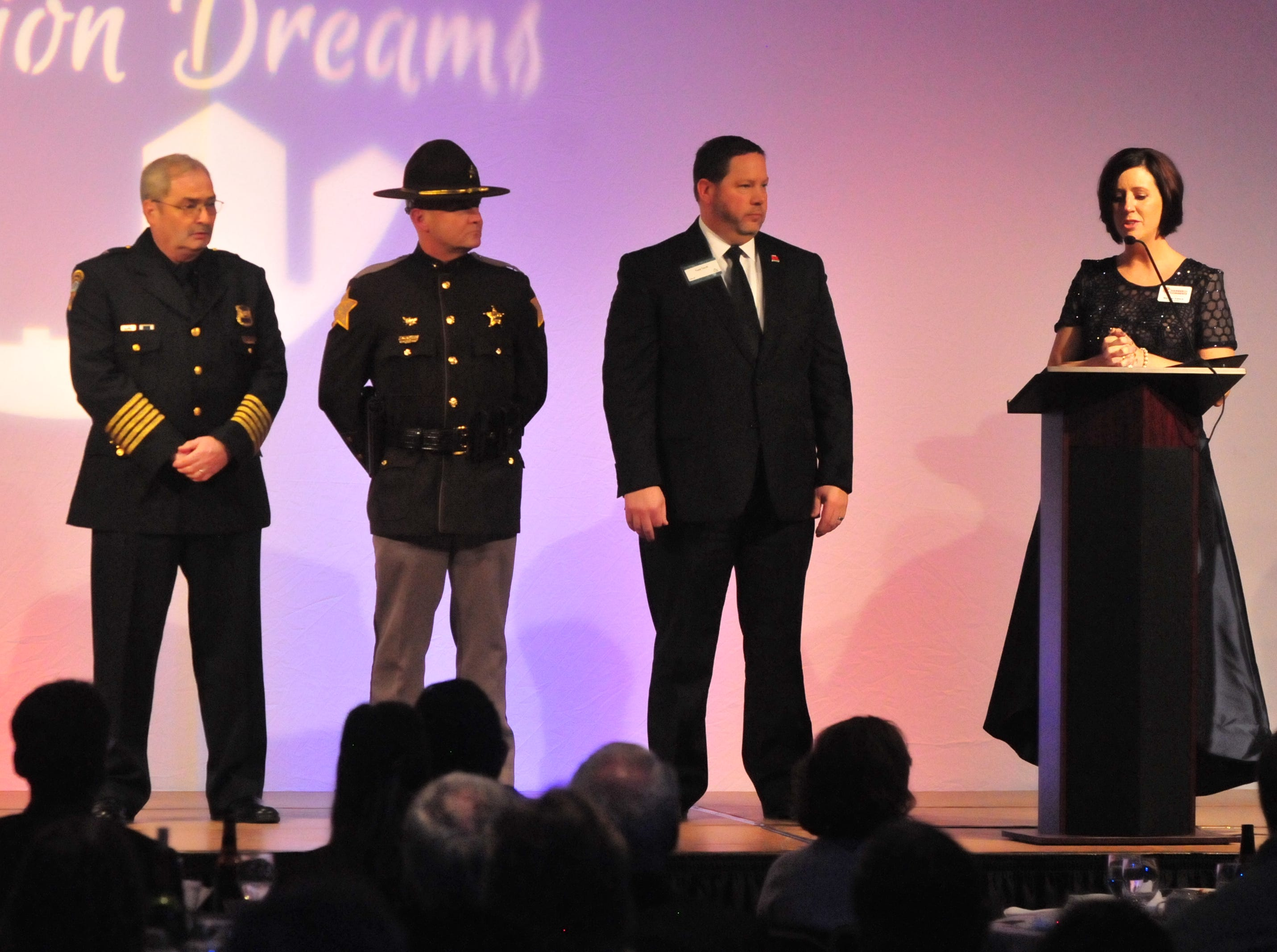Melissa Vance recognizes Richmond Police Department Chief Jim Branum (from left), Wayne County Sheriff Randy Retter and Richmond Community Schools Superintendent Todd Terrill while speaking about the Dec. 13 active-shooter incident at Dennis Intermediate School.